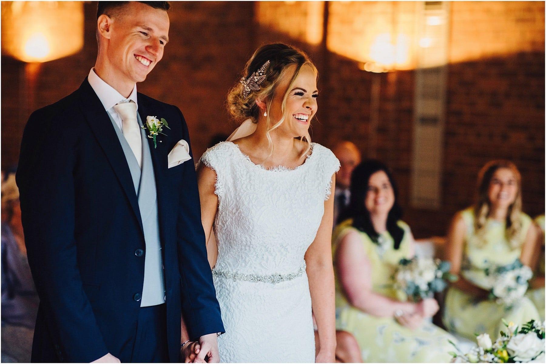 bride smiling at wedding ceremony