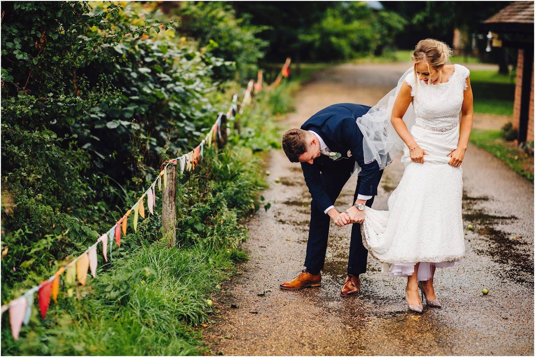 groom rearranging brides dress
