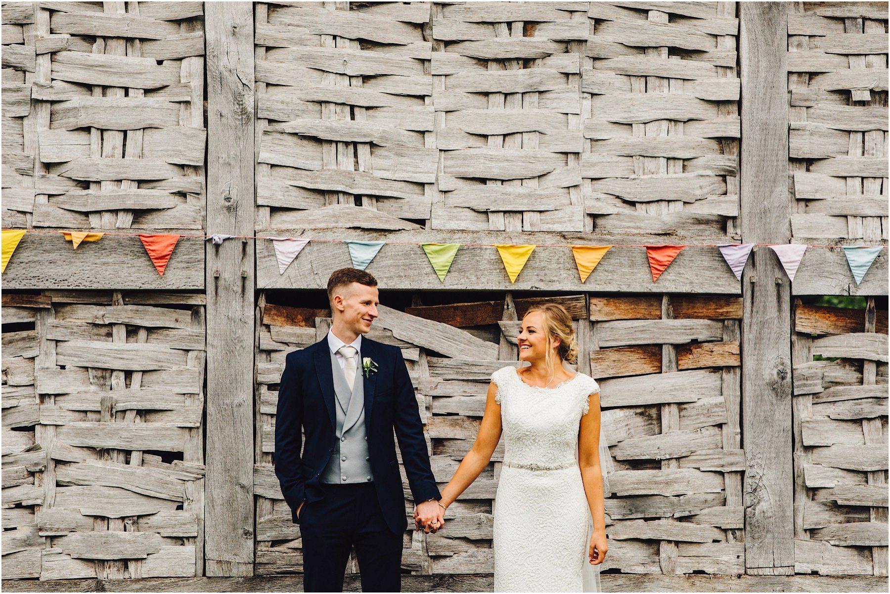 bride and groom under bunting