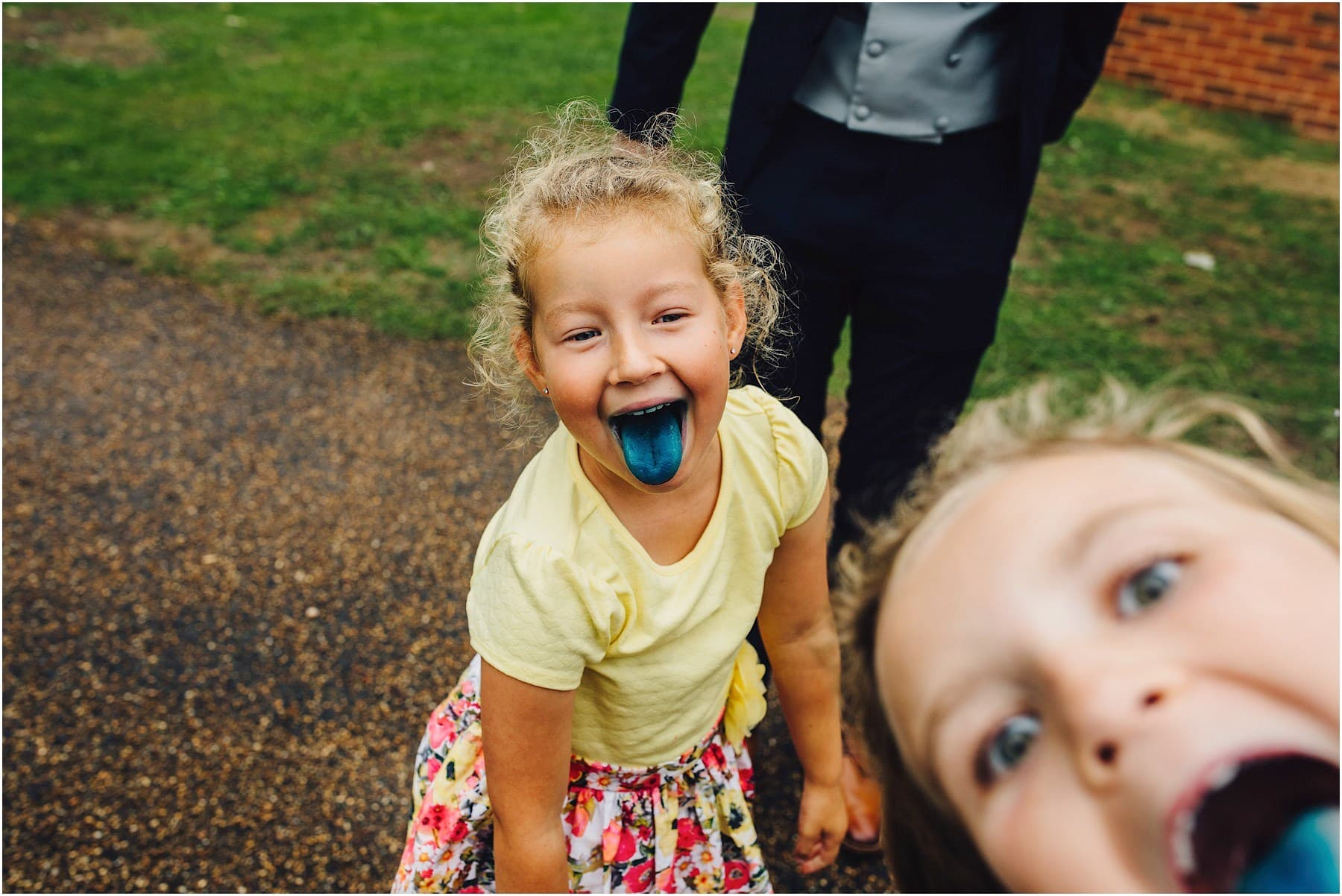 kid with blue tongue at wedding