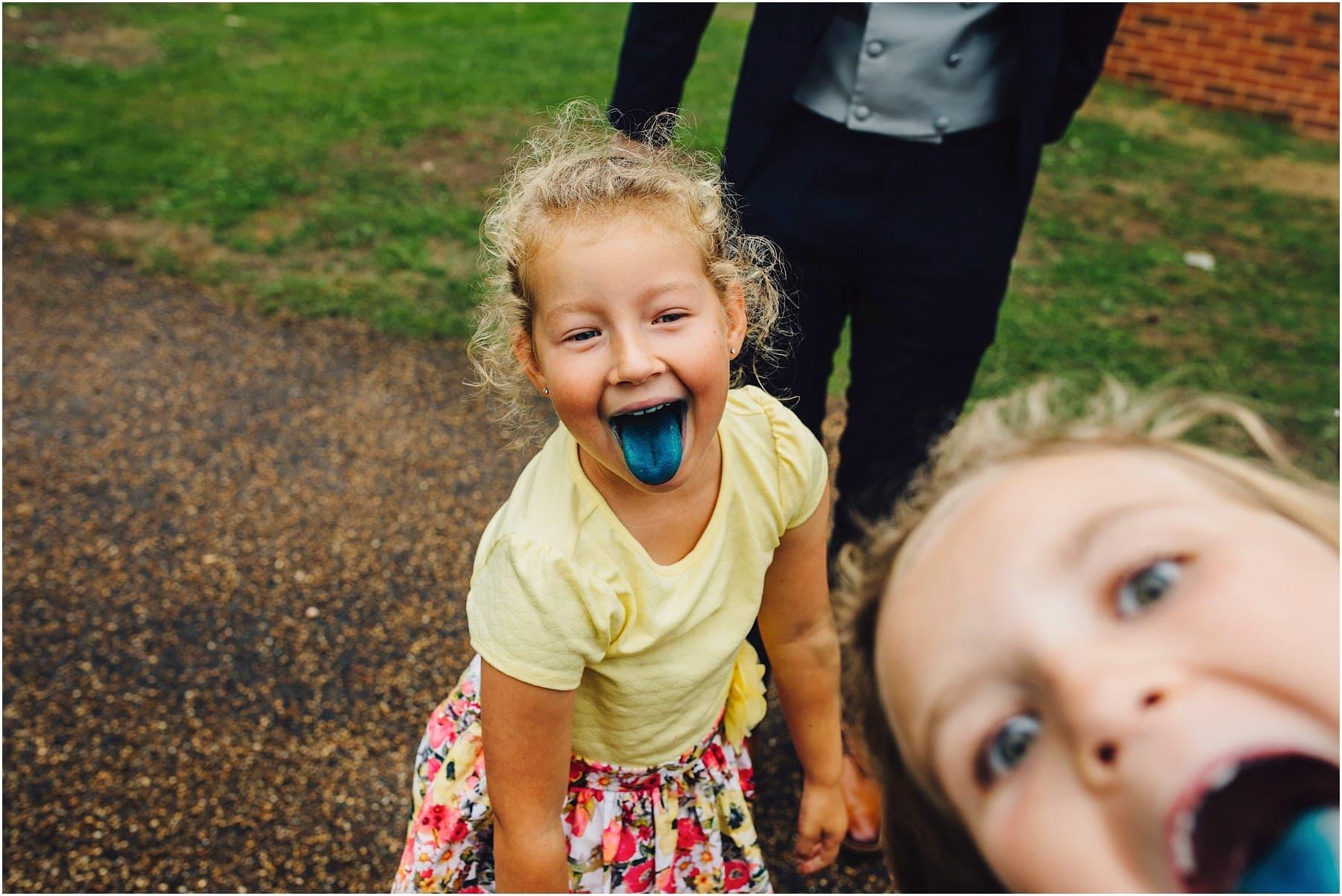kid with blue tongue at wedding