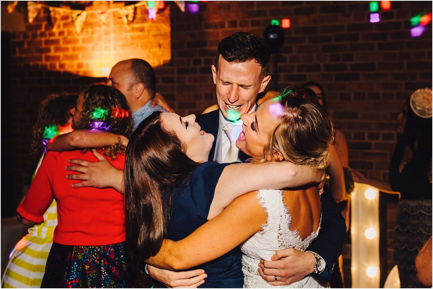 bride and groom dance with friends