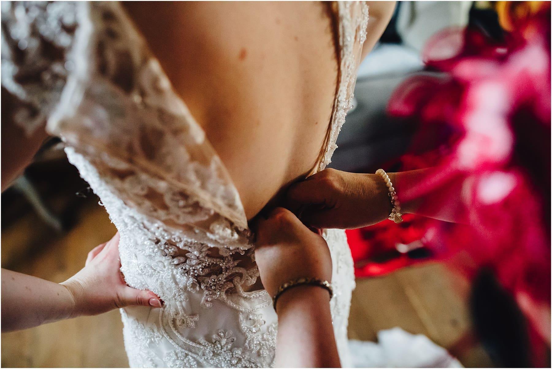 back of brides wedding dress